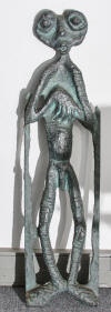 "Lucas SITHOLE LS6732 ""The Innkeeper"", 1967 - wall sculpture in wood, partly burnt, copper oxide applied - 126.5x33.5x?? cm"